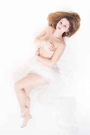 Naked woman on white background looking you photo