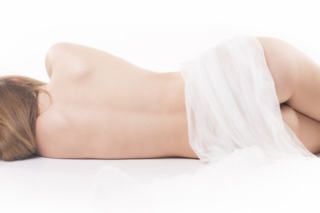 Isolated naked sleeping woman  details with white towell Stock Photo