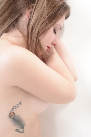 Sweet naked sleeping woman  details with tattoo photo