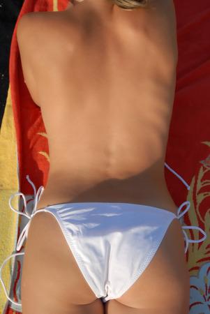 beautifull woman: Beautifull woman ass on a towel on the beach