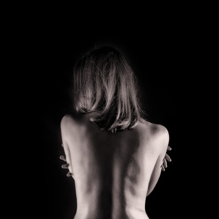 Sexy woman from back on black background photo