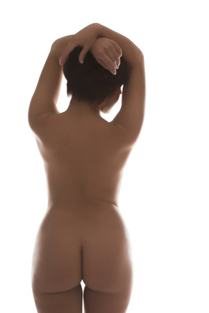 Rear View Of Sexy Nude Woman Over White Background Stock Photo