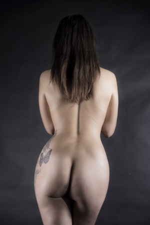 Sexy portrait from back over black background Stock Photo