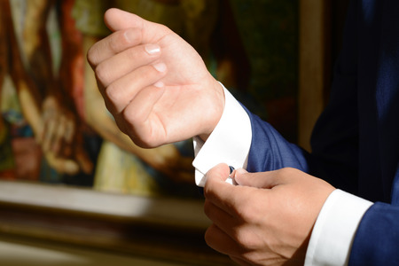 french cuffs: Details of goom hands before the wedding Stock Photo