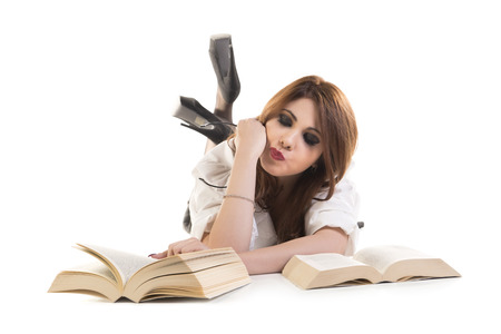 Portrait Of A Woman Holding Eyeglasses Reading Book