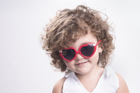 femal: Isolated femal child with red sun glasses Stock Photo