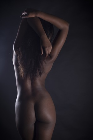 naked african: Rear View Of Sexy Nude Black Woman Over Black Background