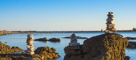 Stone beach in Zabratija at the sunset, Umag, Croatia