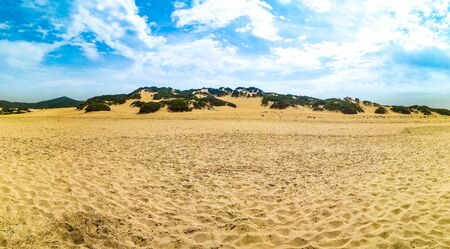 Dune di piscinas with blue sky and clouds Standard-Bild