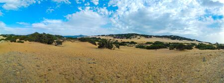 Panoramic view of dune di piscinas with blue sky and clouds