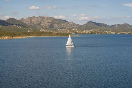 Seaside view of one boat in Golfo Aranci in morning light, Sardinia Italy