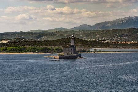 Coastline of Old Saline in Olbia with a building in the sea, Sardinia, Italy