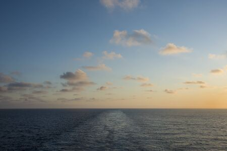 Colorful sunset on the sea with wake of the ship