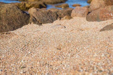 Details of red sand in the una piccola spiaggia (One small beach) Olbia, Sardinia, Italy