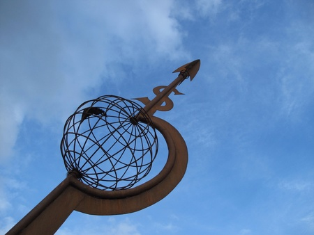 iron: Globe sculpture pointing south