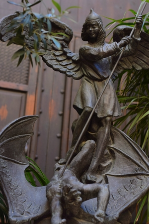 The death of the dragon by Saint Michael the Archangel Editorial