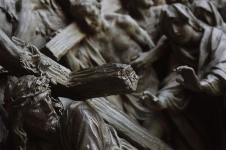 Jesus Christ carrying the cross on the door of Milan Cathedral, Italy