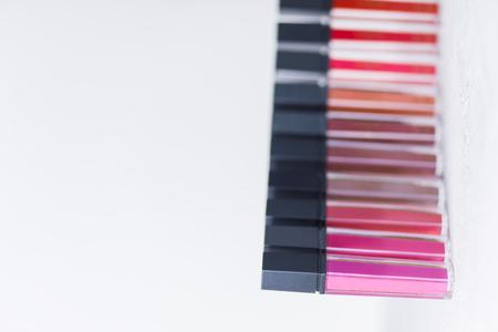 professional cosmetics, bright lipstick, standing on white background, closeup 스톡 콘텐츠