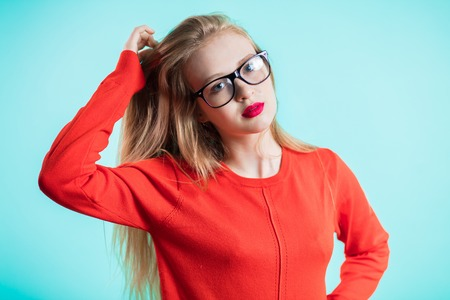 Portrait of beautiful woman with glasses on blue background. Health, good vision, ophthalmology