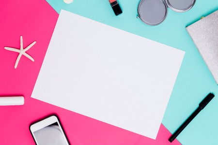 Flat lay white sheet of paper for text and advertising on colorful background with accessories. spring theme