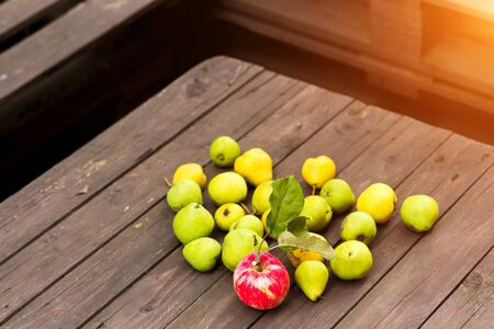 Apples and pears on a wooden background