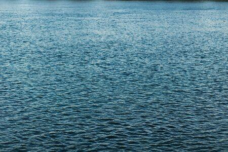 Beautiful blue water texture in summer. River, ocean, sea