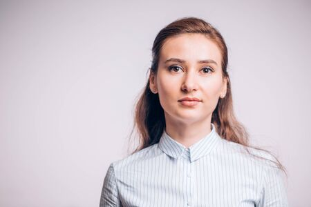 Portrait of a business young woman on a white background. Manager, a banker, a profession Banco de Imagens - 131310154