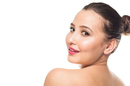 Smiling woman with clean skin on white isolated background. Spa, care, youth, spring. Close up, copy space.