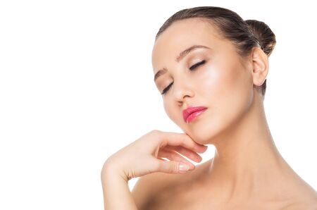 Young attractive girl with clean face skin with closed eyes on white background. Spa, cosmetology, make up, care procedures