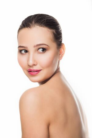 beautiful brunette girl with delicate make-up on white background looking with a smile towards Spa care open off shoulders cosmetics skin