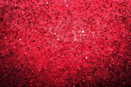 Bright colored red background of shiny stones and crystal, top view, copy space