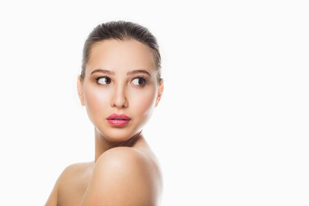 Beauty portrait of female face with natural skin on white isolated background. Spa, care, make up, freshness. Close up, copy space.