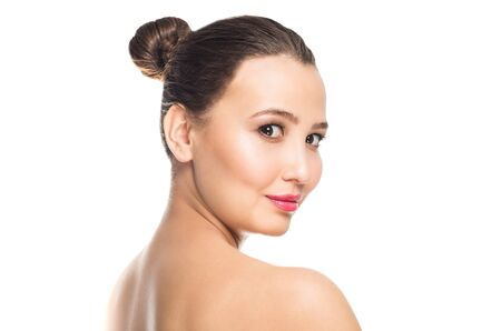 Beautiful brunette Spa woman looking at camera on white isolated background with copy space. Clean face skin, care concept Reklamní fotografie