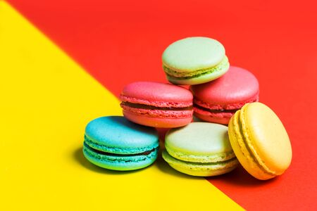 macaroon on colorful red background. Closeup