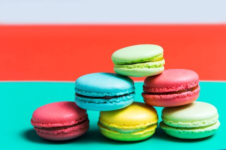 macaroon on turquoise background, colorful cookies, pastel colors. Delicious dessert for Breakfast