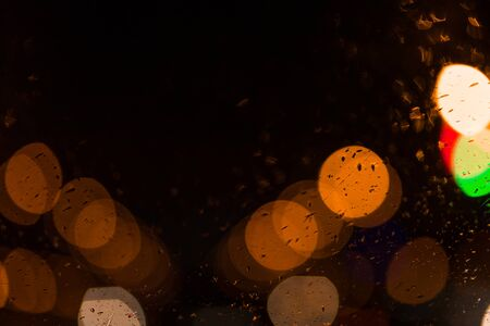 Abstract backgrounds with round bokeh on black background 写真素材
