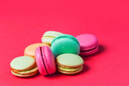 macaroon on pink background with copy space, closeup