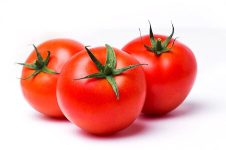 Three ripe red tomatoes on white isolate background, close up