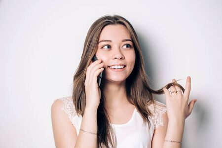 Happy woman phone talking. Face with toothy smile, isolated over white Banque d'images