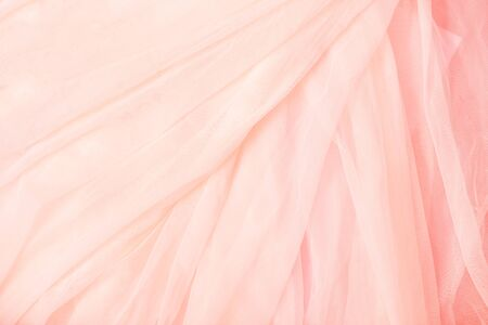 Soft pink coral beige Voile background. Wedding dresses, fabric texture Imagens