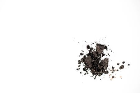 Cosmetic black scattered eye shadows isolated on white background with copy space