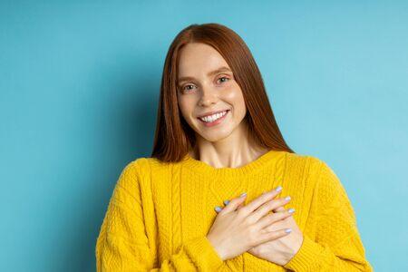 Happy redhead girl smiling looking at camera