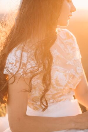 Closeup beautiful silhouette portrait of woman in white dress on nature sunset. Fine art, wedding, lifestyle, love, life concept Stock fotó