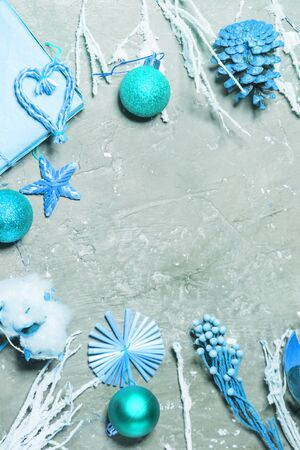 Christmas or New Year background with blue decorations and toys on gray 写真素材