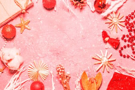 Abstract pink coral Christmas background with toys, decorations with frame for copy space