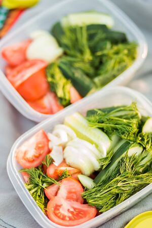 Closeup of delicious fresh raw vegetables from the garden in two containers, top view. Healthy food, diet