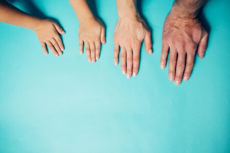 family hands on blue background Imagens