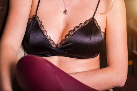 Woman in black bra, close up. Girl in sexy lingerie Stock Photo