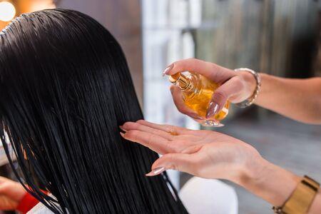 Oil hair treatment for woman. Spa, beauty salon