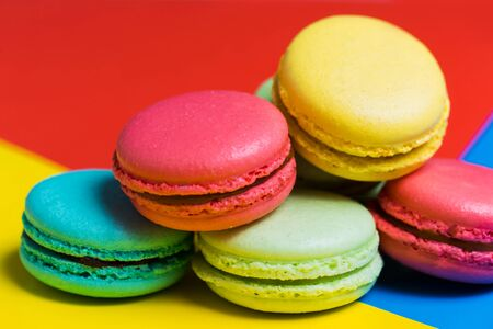 French delicate dessert for Breakfast in the morning. Closeup of colorful macaroons on the table